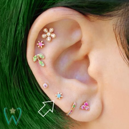 Wish and Whim Jewelry, 14KY Blue Diamond Flower, on Ear 1