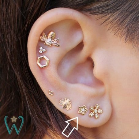 Wish and Whim Jewelry, 14KY Tiny Diamond Flower Stud Earring, on Ear 1